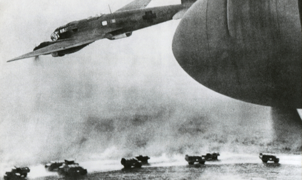 German bombers fly over Nazi invasion vehicles